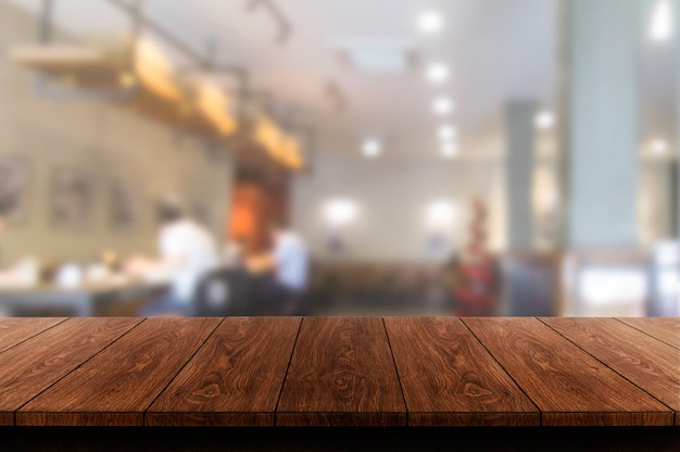 Wood table of modern restaurant Premium Photo