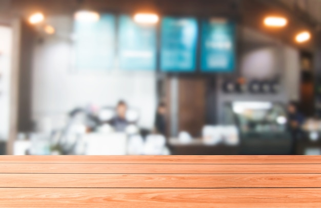 Wood table of modern restaurant Premium Photo