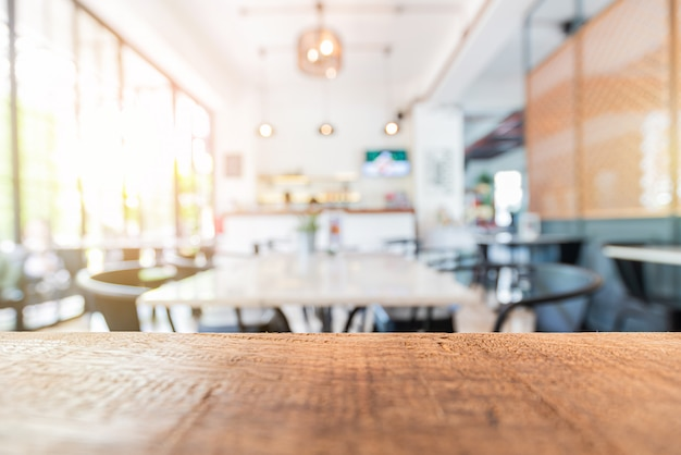 Wood table in restaurant and blurred interior decor Premium Photo