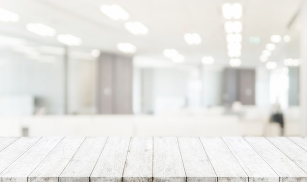 Wood Table Top And Blurred Bokeh Office Interior Space