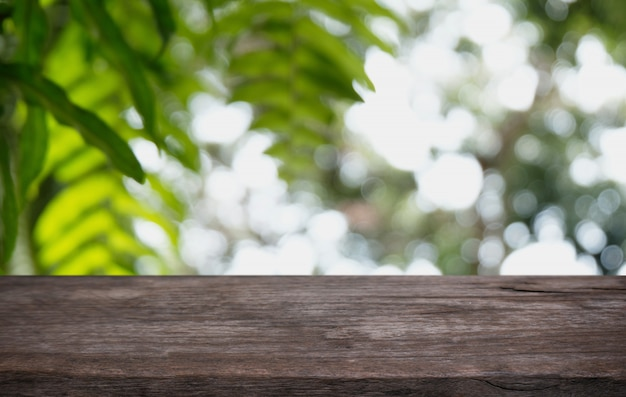 Wood table top in blur background room interior with empty copy space. Premium Photo