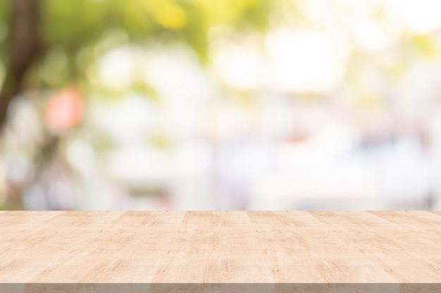 Wood table top on blurred background at garden Premium Photo