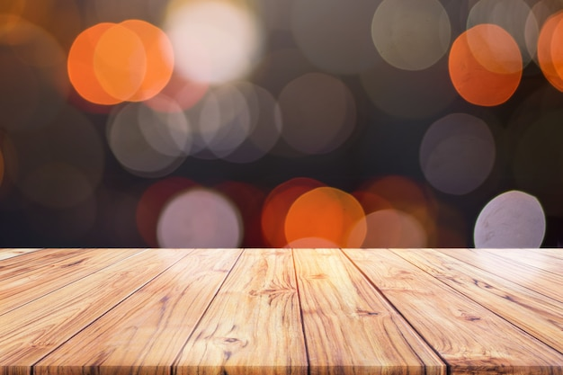 Wood table top counter on night city lights bokeh background,lights blurred bokeh blurred background Premium Photo