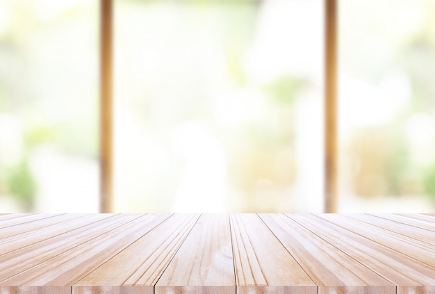 Wood table top on disfocus kitchen  background Premium Photo