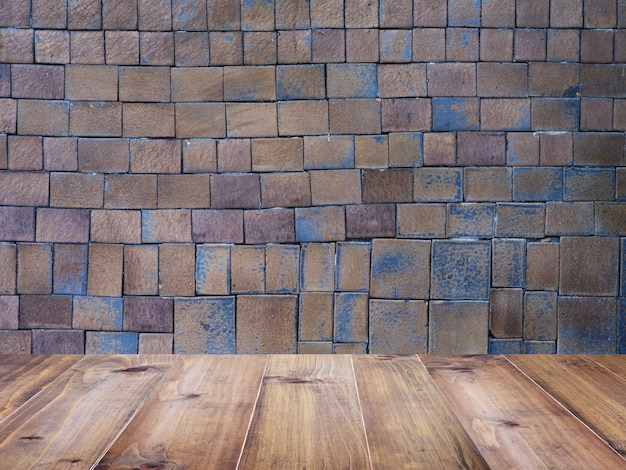 Wood Table Top Over Square Clay Tiles And Brick Wall Pattern Photo