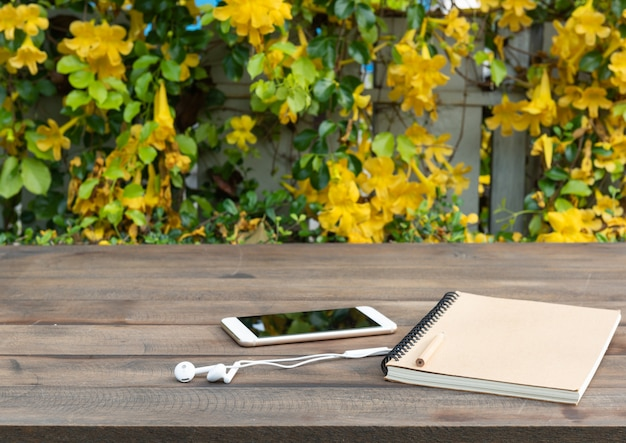 Wood table with beautiful yellow flowers background Premium Photo