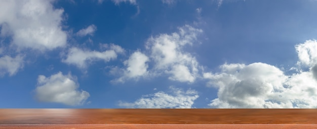 Wood table with blue sky background with rainy cloudy in poor