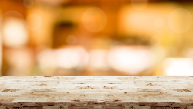 Wood table with blurred interior in cafe background Premium Photo