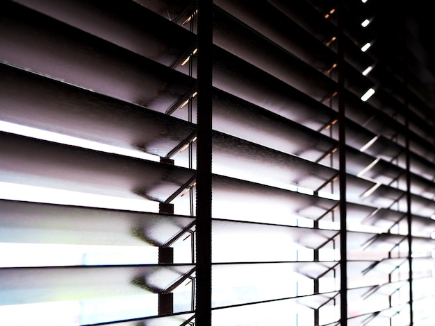 Wood venetian blinds, curtains decorate the room and protect the sunlight Premium Photo