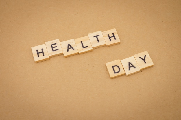 Wood word health day using as background universal day concept and health day Premium Photo
