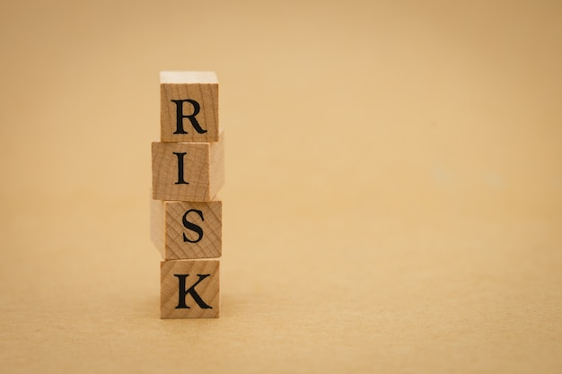 Wood word risk using as background business concept and risk concept Premium Photo