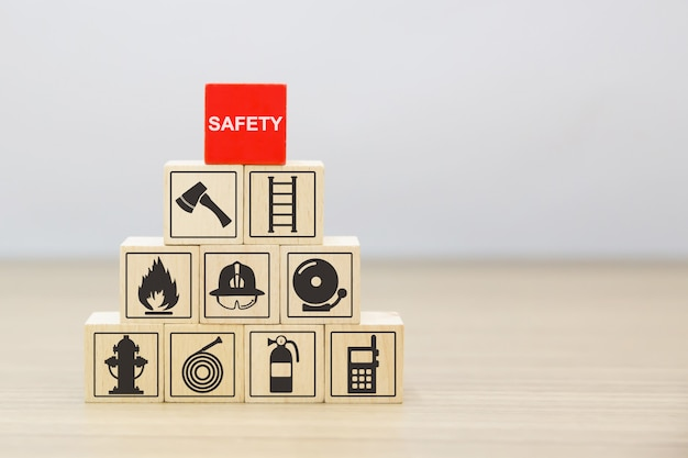 Wooded blocks stacking with safety icons. Premium Photo