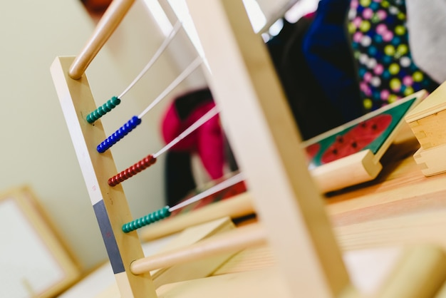 Wooden abacus to learn to count and do addition and subtraction, montessori education for children. Premium Photo
