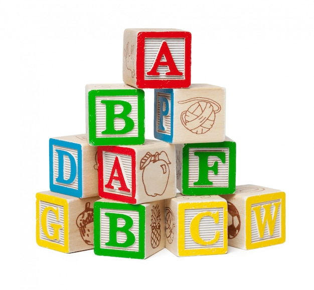 Wooden alphabet blocks isolated on white background Premium Photo