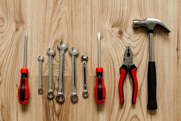 Wooden background with different tools Free Photo