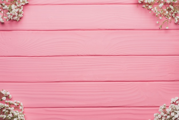 Wooden background with floral decoration on the corners Free Photo
