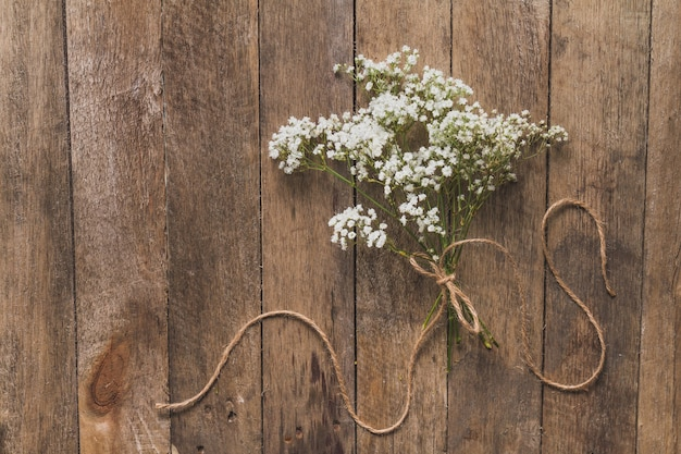 Wooden background with floral decoration Free Photo