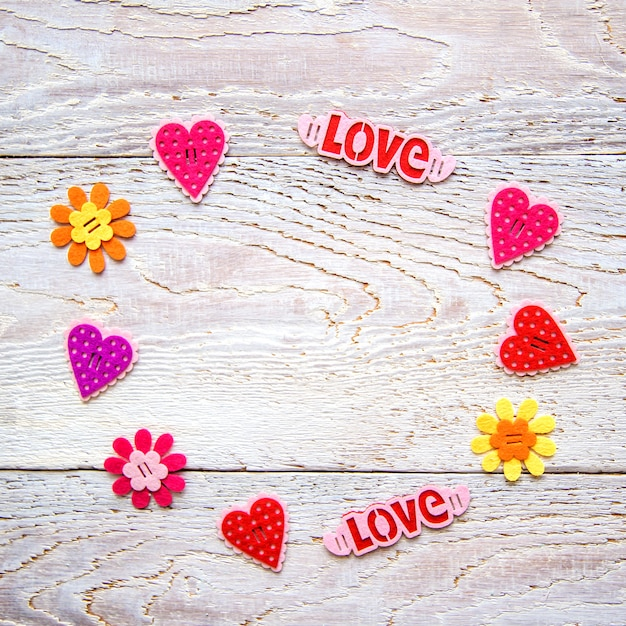 Wooden background with hearts and words Premium Photo