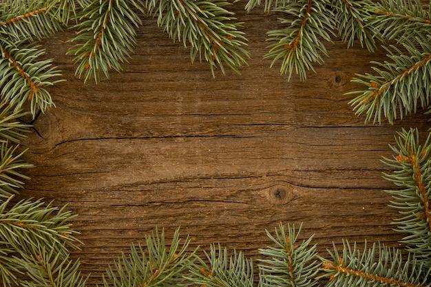 Wooden background with pine needles Premium Photo