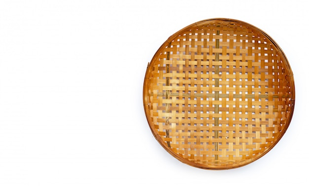 Wooden bamboo threshing basket on white background. Premium Photo