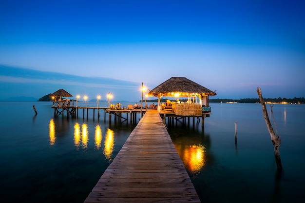 Wooden bar in sea and hut with night sky in koh mak at trat, thailand. summer, travel, vacation and holiday. Premium Photo