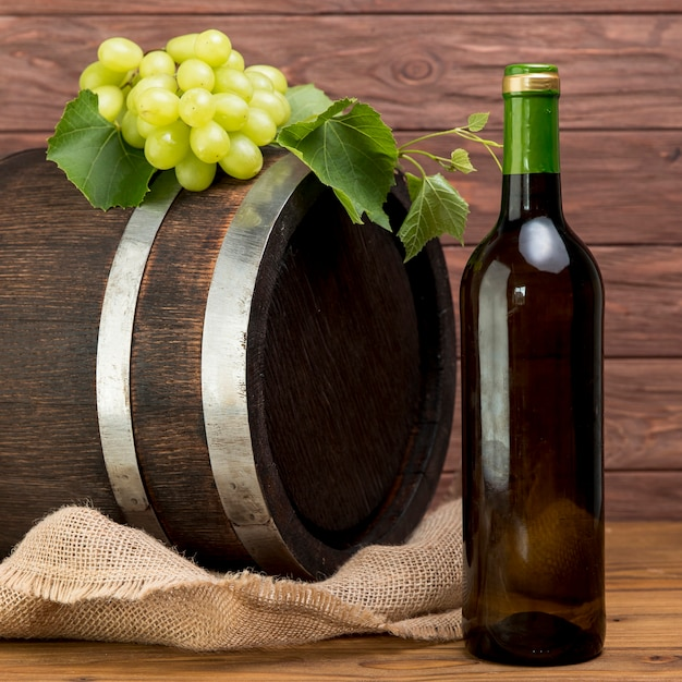Wooden barrel with bottle and glass of wine Free Photo