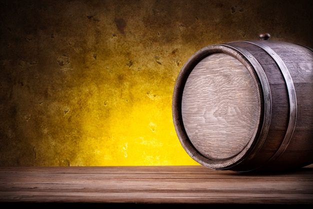 Wooden barrel on yellow gradient Premium Photo