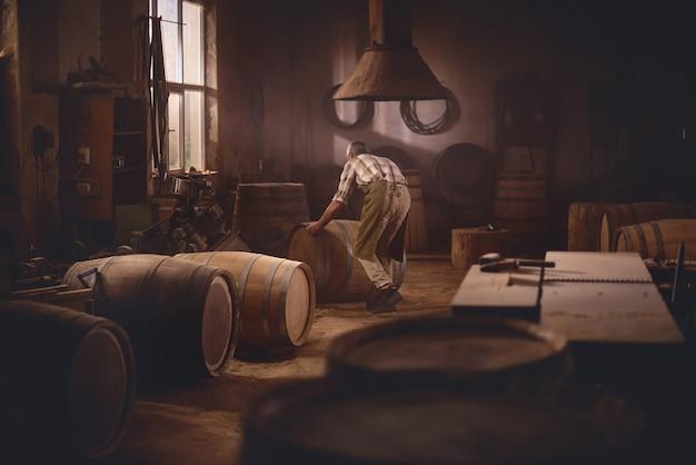 Wooden barrels in a cooperage, barrel workshop Premium Photo