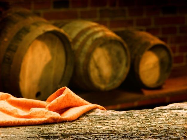 Wooden barrels in a wine tasting cellar Premium Photo
