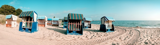 Wooden beach chairs on island rugen, northern germany Premium Photo