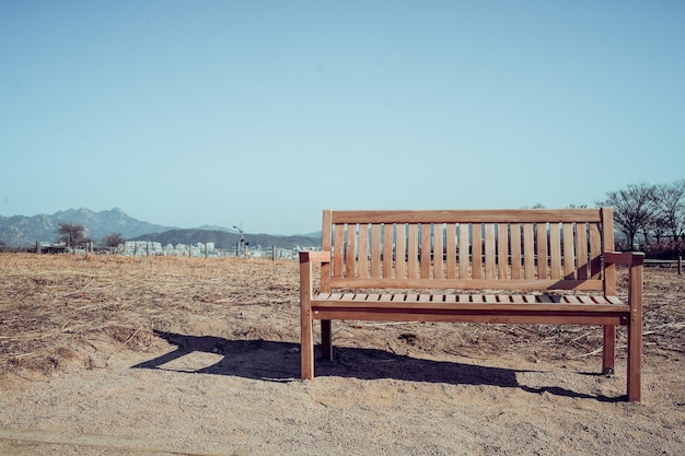 Super Wooden Bench With Mountains Background Photo Premium Download Ibusinesslaw Wood Chair Design Ideas Ibusinesslaworg