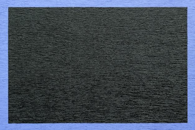 Wooden black background framed by a blue frame. Premium Photo