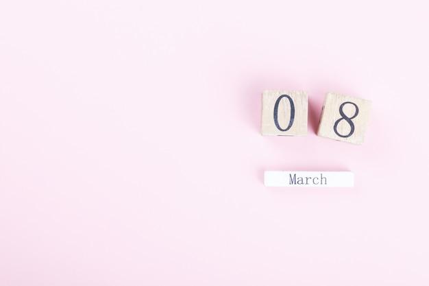 Wooden block calendar international of march 8  womens day Premium Photo