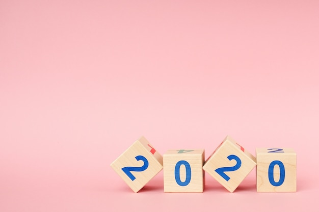 Wooden block cube with number new year 2020 Premium Photo