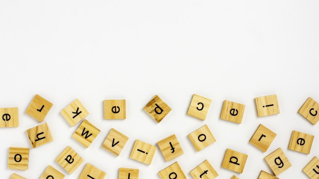 Wooden blocks alphabet isolated on white background Premium Photo