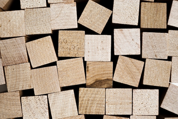 Wooden blocks stacked for seamless background Premium Photo