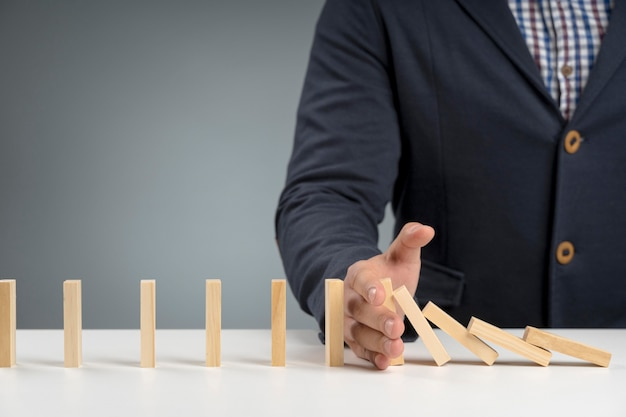 Wooden blocks stopped from falling Free Photo