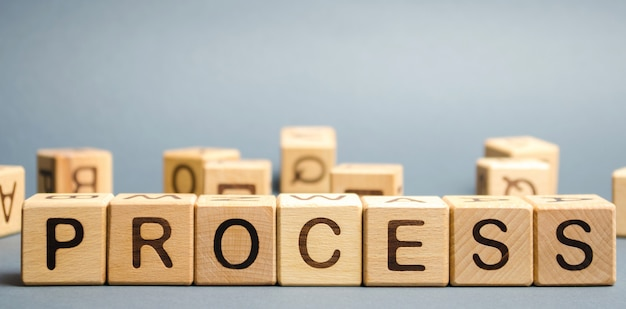 Wooden blocks with the word process. business management concept. Premium Photo