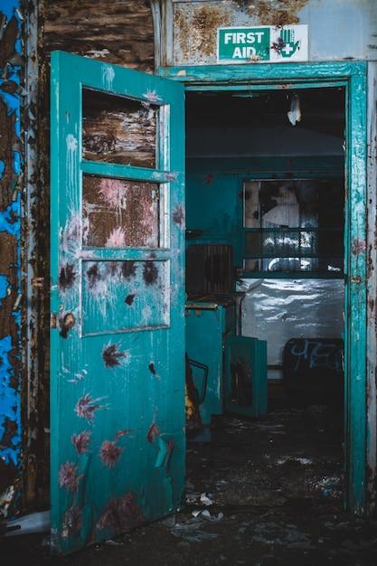 Wooden blue open door in abandoned house Free Photo