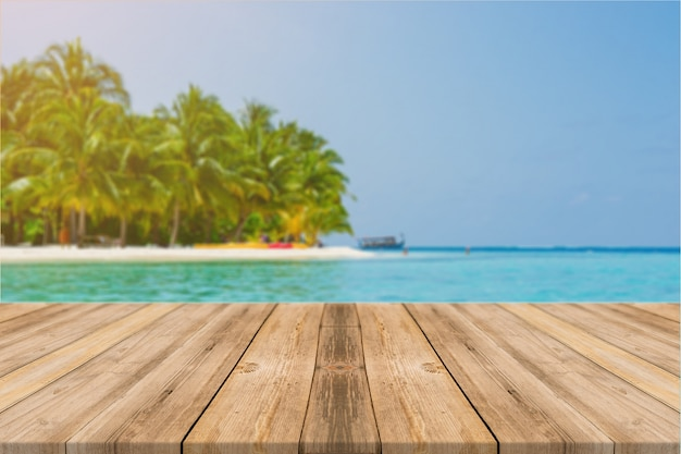 Wooden board empty table in front of blue sea & sky background. perspective wood floor over sea and sky - can be used for display or montage your products. beach & summer concepts. Free Photo
