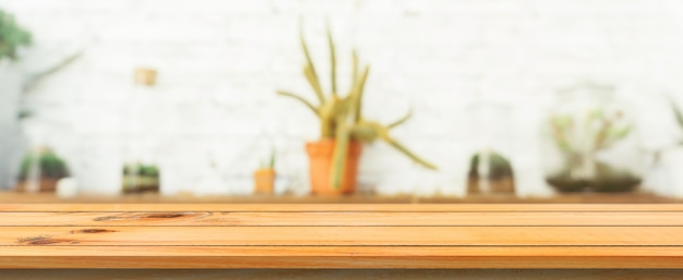 Wooden board empty table top blurred background. perspective brown wood table over blur in coffee shop background. panoramic banner - can be used mock up for montage products display or design. Free Photo