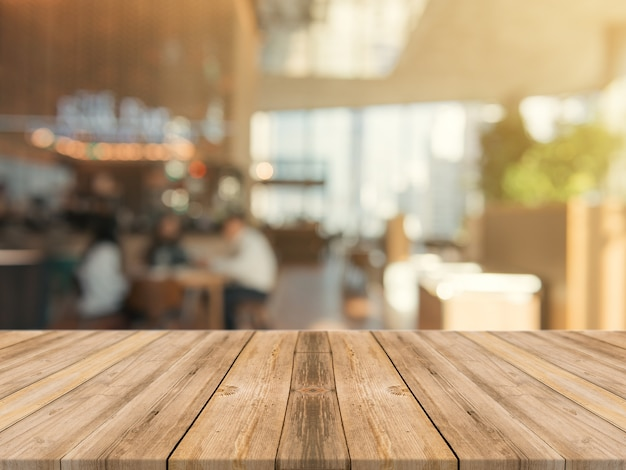 wooden board empty table top on of blurred background