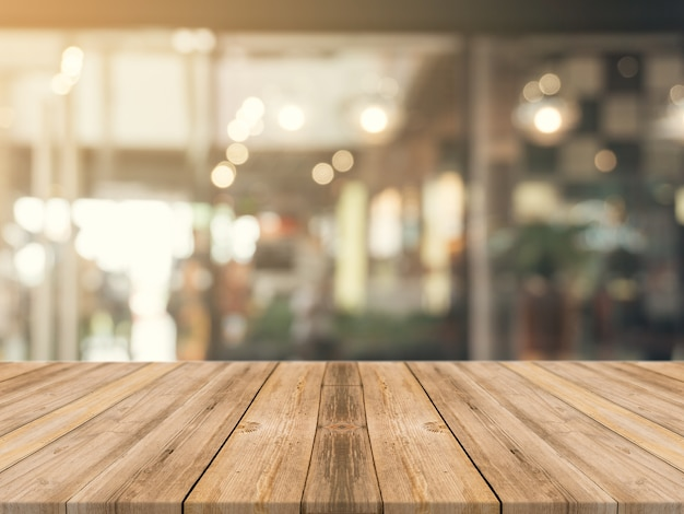 Premium Photo | Wooden board empty table top on of blurred ...