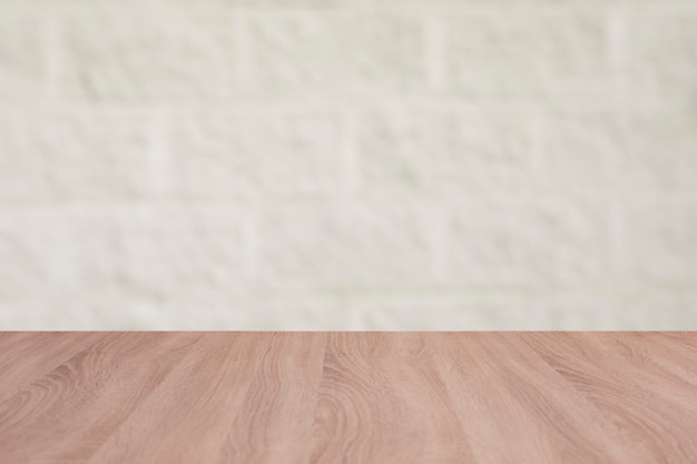 Wooden board empty table with a background of bricks Free Photo