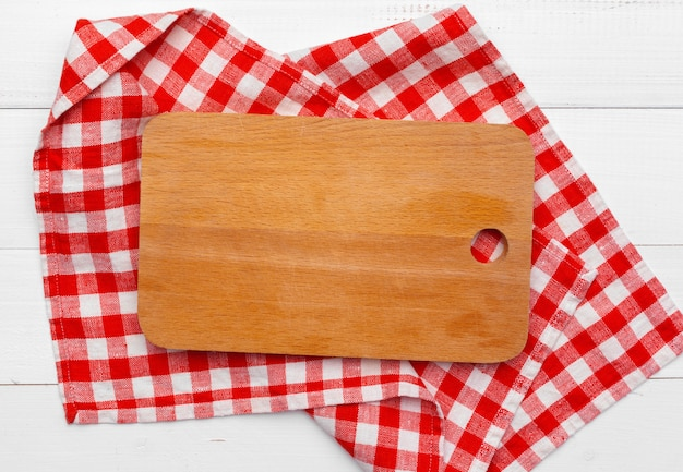 Wooden board stand on tablecloth Premium Photo