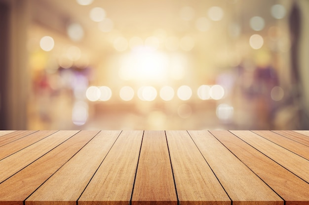 Wooden board or table and abstract blurred background