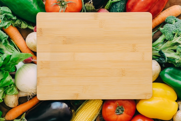 Wooden board on vegetables Free Photo