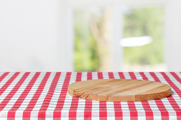 Wooden board with a napkin on a table Premium Photo