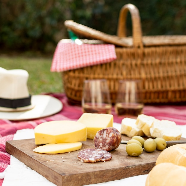 Wooden board with picnic goodies Free Photo