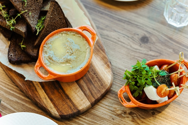 Wooden board with rye crackers with rosemary Premium Photo